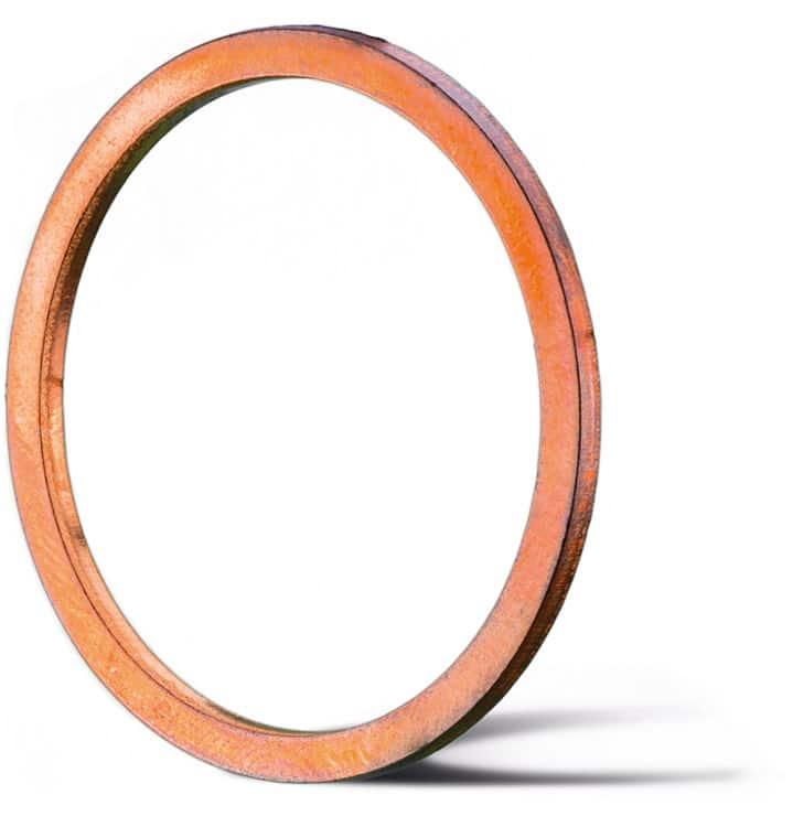 Deutsch: Abbildung zeigt einen Metalldichtring aus dem Grundmaterial Kupfer für Hochdruckanwendungen. English: Picture displays a copper ring seal for high pressure applications.