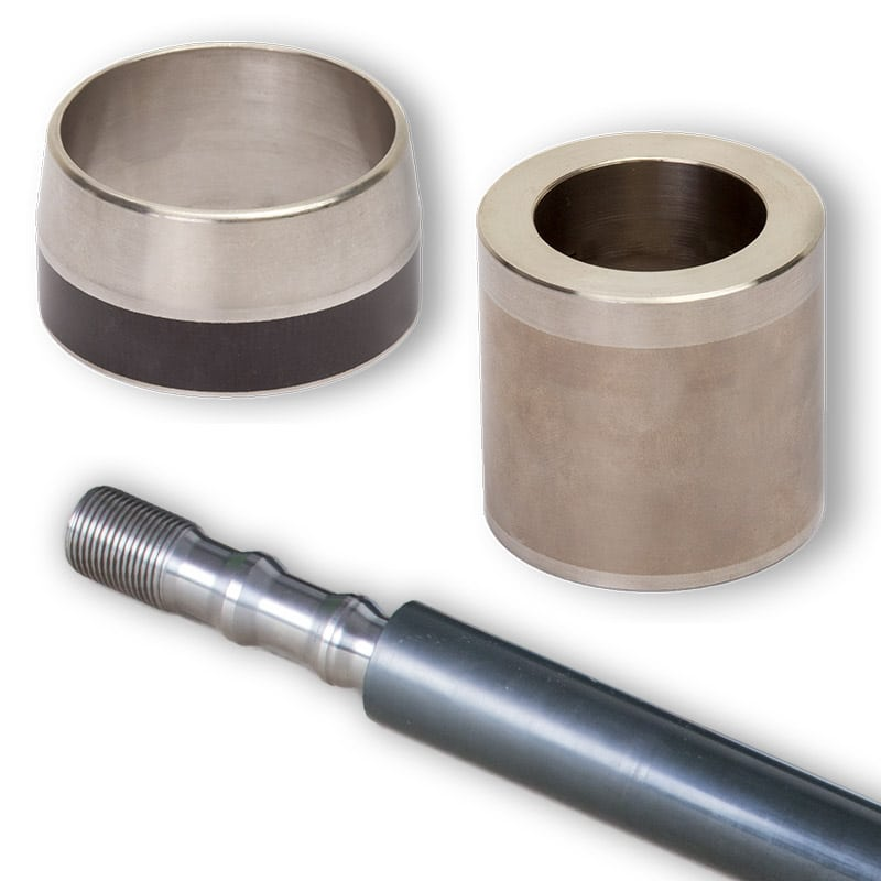 Deutsch: Abbildung zeigt beschichtete Wellenschonhülsen und einen Beschichteten Plunger English: Picture displays coating on different shafts and other mechanical parts